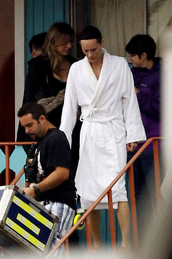 "**EXCLUSIVE** Jared Leto wears a robe and hair net as he walks around the set of ""Dallas Buyers Club"" in New Orleans"